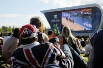 28-07-2012 - Sports fans kitted out in Team GB colours relaxing and watching the action together at the Park Live big screen inside the Olympic Park in Stratford. © Stefano Cagnoni