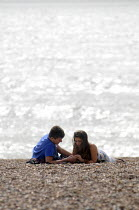 10-09-2012 - Couple sharing a quiet moment together on the beach at Brighton. © Stefano Cagnoni