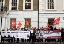 28-04-2014 - Campaigners hold Red Cards at the Qatari embassy in London as part of Workers Memorial Day protest against loss of lives in the construction industry building the stadiums for the 2022 Football World... © Stefano Cagnoni