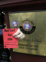 28-04-2014 - Red Card at the Qatari embassy in London, part of Workers Memorial Day protest against loss of lives in the construction industry building the stadiums for the 2022 Football World Cup to be held in Qa... © Stefano Cagnoni