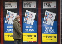 07-05-2015 - General Election, 2015. Man passing by William Hill bookmakers shopfront advertising the betting odds on the General Election result, Holloway, north London. © Stefano Cagnoni