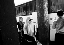 01-03-2004 - A young woman wears a hijab as she makes her way to a bus in Zerqa, near the capital Amman, Jordan, 2004 © Steven Langdon