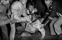 12-10-1984 - Miners at Brodsworth colliery, South Yorkshire help their colleague who has been beaten to the ground and injured by the police © Sean Smith