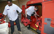 01-06-2002 - Starburst team postmen at Camberwell sorting office loading a royal mail van preparing for their delivery rounds © Janina Struk