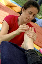 09-09-2007 - Reflexology practitioner with patient at Urban Green Fair, Brockwell Park, London. © Janina Struk
