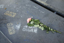 04-02-2015 - Graffiti reading Je Suis Charlie and a single rose placed in memory of those journalists who died in the terrorist attack at Charlie Hebdo, Place de la Republique, Paris. © Janina Struk
