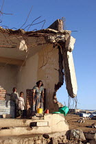 06-09-2005 - A family in the town of Zala Anbessa largely destroyed in the border war between Ethiopia and Eritrea, Ethiopia 2004 © Boris Heger