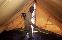 05-03-2005 - Spraying against mosquitoes to stop spread of malaria and dengue fever in camps for families displaced by the Tsunami, a programme implemented by the local health office but financed by Oxfam. Vattava... © Howard Davies