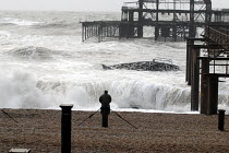 10-03-2008 - A man watching waves by the ruins of the West Pier during a winter storm. Brighton UK 2008 © Howard Davies