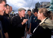 01-08-2004 - Pro and anti hunt protestors debate outside the Labour party conference during a protest against the ban on fox hunting , Brighton, UK 2004 © Howard Davies