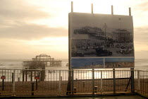 18-01-2007 - A poster shows Brighton Victorian West Pier in its heyday while winter storms batter the remains of the Pier. Plans to demolish the Pier and replace it with a viewing tower called i360 have been propo... © Howard Davies
