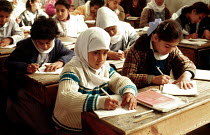 01-07-1993 - Palestinian refugee children studying at an UNRWA school, refugee camp, Gaza. 1993 © Howard Davies