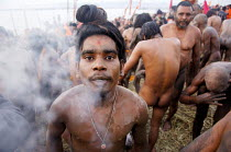 20-02-2007 - A holyman smokes hashish at the Kumbha Mela festival 2007, the largest gathering of people on the planet. 30 million Hindus and holy men known as Sadhus come to cleanse their sins in the Ganges River,... © Tom Parker