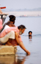 02-02-2007 - Varanasi, Northern India where millions of pilgrims come each year to wash away their sins in the River Ganges. Hindu Shivaratri festival. © Tom Parker