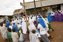 11-05-2003 - The Legion Maria church, an offshoot of the Catholic Church, hold a service in Mathare slum in Nairob, The church is active in Kenyas slums which have given birth to hundreds of indegenous churches. N... © R. Chalasani