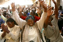 11-05-2003 - Kenyans with HIV/AIDS and their families at a service at Gods Power Church where they believe they might be cured. In a country where health care is minimal and most cant afford treatment for AIDS man... © R. Chalasani