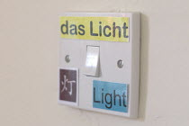 09-03-2011 - Light switch with labels saying light in English, German and Chinese as a learning tool for a trilingual child growing up with these languages. © Timm Sonnenschein