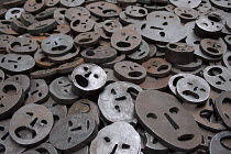 06-04-2013 - The Jewish Museum, Berlin, Shalechet (Fallen Leaves), Art in the Memory Void by the artist Menashe Kadishman. Over 10,000 open-mouthed faces coarsely cut from heavy, circular iron plates cover the flo... © Timm Sonnenschein