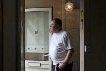 08-05-2013 - Michael, in his council flat in Ladywood, Birmingham. He was asked to pay bedroom tax for two room, which would take him into debt. He initially moved in the house with his parents in 1970, later live... © Timm Sonnenschein