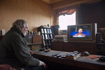 05-30-2013 - Watching TV news reporting the increased usage of food banks, council flat, Highgate, Birmingham. He was asked to pay bedroom tax for one room, which would take him into debt. He moved into the flat t... © Timm Sonnenschein