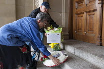 06-15-2013 - Anti bedroom tax protest, Birmingham. Maria Brabiner and Ray Davis lay down a wreath and flowers outside the council house in memory of Stephanie Bottrill, who committed suicide because she couldnt pa... © Timm Sonnenschein