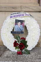 06-15-2013 - Anti bedroom tax protest, Birmingham. A wreath laid outside the council house in memory of Stephanie Bottrill, who committed suicide because she couldnt pay the bedroom tax. © Timm Sonnenschein