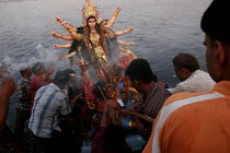 01-02-2009 - Statue of the Hindu Goddess Durga being immersed into the River Yamuna, Festival of Dusshera, India © Tashi Tobgyal