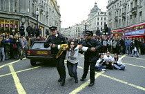 23-01-2003 - London Based Supporters of the PKK Kurdistan Workers Party Leader Abdullah Ocalan stage a Sit Down Protest in Oxford Circus, Central London which succeeded in Holding up and Stopping Traffic. Police O... © Paul Mattsson