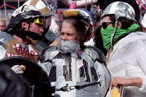 11-09-2001 - Protesters in riot gear. Protest against DSEI Arms Fair, London Docklands, UK © Paul Mattsson