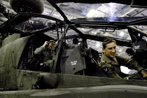 09-09-2003 - British Army Air Corps pilots in the cockpits of the Agusta Westland Apache helicopter gunship on display, this powerful machine has recently gone into operational service . Defence Systems and Equipm... © Paul Mattsson