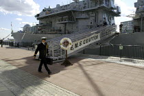 09-09-2003 - A Naval officer walks past HMS Grafton, a British Royal Navy Duke Class Anti Submarine frigate which is moored at the side of Royal Victoria Dock. Defence Systems and Equipment International Exhibitio... © Paul Mattsson