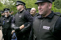 10-09-2003 - An anti arms trade protester is arrested and has his arm twisted by Metropolitan Police officers while protesting outside the Defence Systems and Equipment International Exhibition at Excel, Docklands © Paul Mattsson