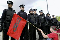 10-09-2003 - Anti arms trade protesters stage a spontaneous sit down and block one of the roads leading to the Defence Systems and Equipment International Exhibition at Excel, Docklands © Paul Mattsson