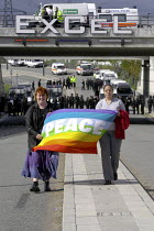 10-09-2003 - Anti arms trade protesters holding a rainbow coloured peace flag march through police lines near the Defence Systems and Equipment International Exhibition at Excel, Docklands © Paul Mattsson