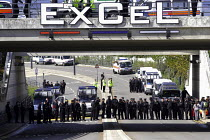 10-09-2003 - Heavy police presence to stop anti arms trade protesters getting into the Defence Systems and Equipment International Exhibition at Excel, Docklands © Paul Mattsson
