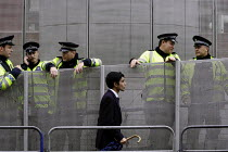 10-09-2003 - British Transport Police officers guard Custom House Station outside the Defence Systems and Equipment International Exhibition at Excel, Docklands © Paul Mattsson