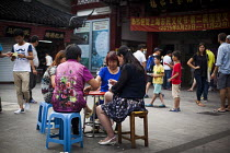 03-09-2015 - Women gambling and playing cards on a street corner, Old City of Shanghai, China. © Connor Matheson