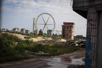 10-09-2015 - Ferrice wheel of an Amusement Park and housing construction, Kunming, Yunnan Province, China. © Connor Matheson