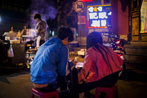 12-09-2015 - A young couple eating street food. Kunming, China. © Connor Matheson