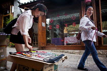 22-09-2015 - Young people selling handmade jewellery to wealthy Chinese tourists. Lijiang, Yunnan Province, China. © Connor Matheson