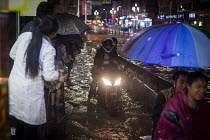22-09-2015 - A motorcycle, flooding after heavy rain. Lijiang, Yunnan Province, China. © Connor Matheson