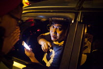 26-09-2015 - A taxi driver speaking to customers. Kunming, China. © Connor Matheson