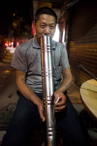 28-09-2015 - A man smoking a cigerette through a bong. Dongchuan, Yunnan Province, China. © Connor Matheson