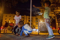 28-09-2015 - Children playing on the street late at night. Dongcheng, Yunnan Province, China. © Connor Matheson