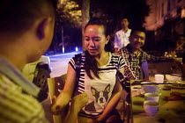 28-09-2015 - Chinese drinkers playing finger guessing drinking game at a bar. Dongcheng, Yunnan Province, China. © Connor Matheson