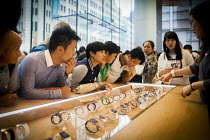 04-10-2015 - Wealthy Chinese tourists enquiring about the Apple Iwatch with a shop assistant, Apple Store, Nanjing Road, Shanghai, China. © Connor Matheson
