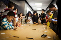 04-10-2015 - Wealthy Chinese tourists looking at the Iphone. Apple Store, Nanjing Road, Shanghai, China. © Connor Matheson