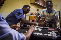20-07-2015 - Malta, Mahjoub, a Sudanese refugee playing cards with his friends who are also refugees from Sudan. Valletta, Malta. © Connor Matheson