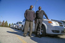 13-11-2015 - Taxi drivers waiting to pickup passengers, St Louis airport, Missouri. They belong to the Taxi Alliance. Joshua Osho (r) is a driver from Nigeria, and the head of the association Mohamed Hussain (l) i... © David Bacon
