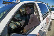 13-11-2015 - Taxi drivers waiting to pickup passengers, St Louis airport, Missouri. They belong to the Taxi Alliance. Mohamed Hussain is a driver from Somalia. © David Bacon